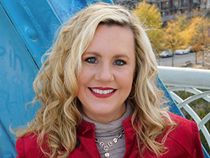 Woman Auctioneer Paige Holt Compass Auctions
