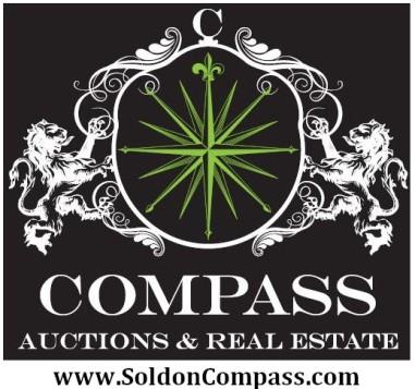Compass lion logo green center & website