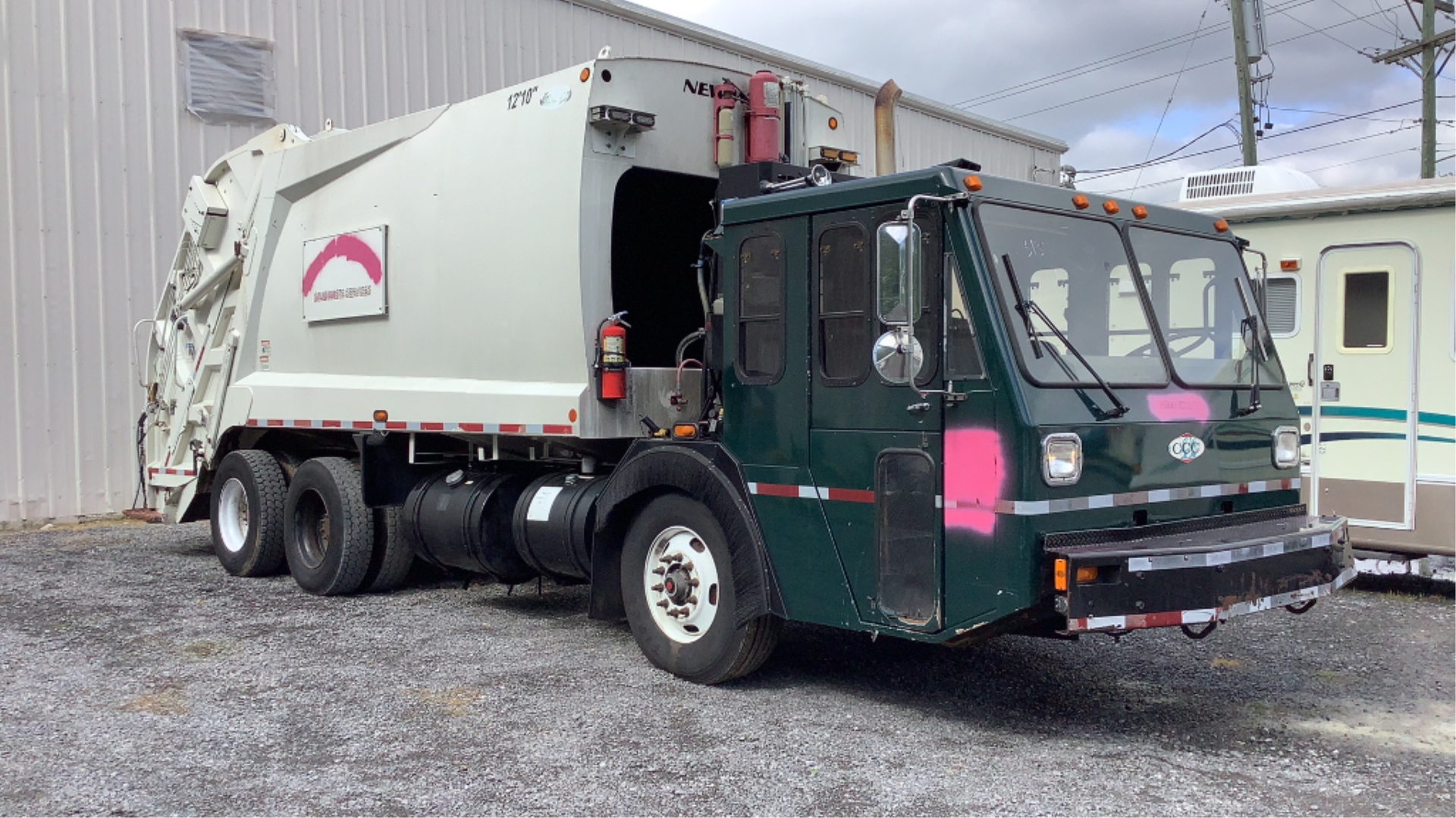 2011 Crane Carrier Company Low Entry Garbage Truck